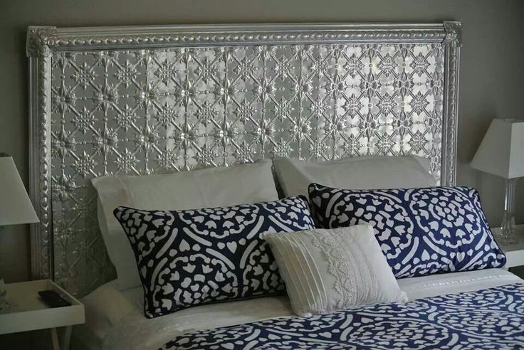 Pressed tin headboard - I'm not in love with this particular example, though, I do value the idea.