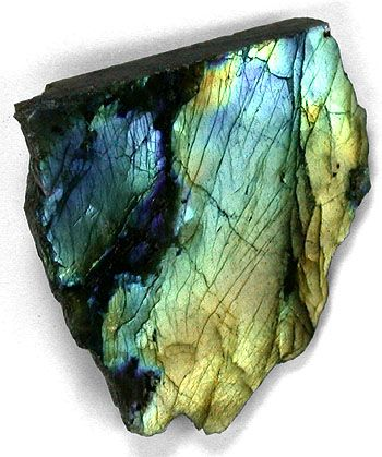 Labradorite ~ The geological type area for labradorite is Paul's Island near the town of Nain in Labrador, Canada. It has also been reported in Norway and various other locations worldwide.  It occurs in large crystal masses in anorthosite and shows a play of colors called labradorescence. The labradorescence, or schiller effect, is the result of light refracting within lamellar intergrowths resulting from phase exsolution on cooling in the Boggild miscibility gap, An4...: