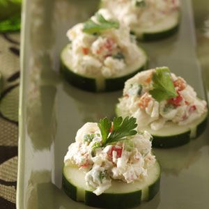 Crab Cucumber Bites - 3 medium cucumbers; 2/3 cup reduced-fat cream cheese; 2 teaspoons lemon juice; 1 teaspoon hot pepper sauce; 1 package (8 ounces) imitation crabmeat, chopped;  1/3 cup finely chopped sweet red pepper; 2 green onions, sliced. http://www.tasteofhome.com/Recipes/Crab-Cucumber-Bites