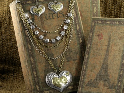 """A 3"""" """"Love"""" heart pendant in burnished silver- and gold-tone hangs from this designer-style multi-layered adjustable beaded necklace with crystals (17"""" at shortest, 25"""" at longest). Comes with matching pierced wire earrings. Lead Compliant."""