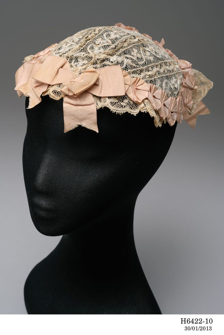 Woman's headdress, cotton, silk, Australia, 1865 -1890/Boudoir caps were worn by fashionable women at home to keep their hair intact either while sleeping or doing the chores. The fashion coincided with the popularity of 'finger wave' hair styles which were styled with heated scissor-like hair crimpers and potions to keep them flat and close to the head...