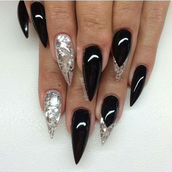 Black stiletto nails with glitter and silver foil