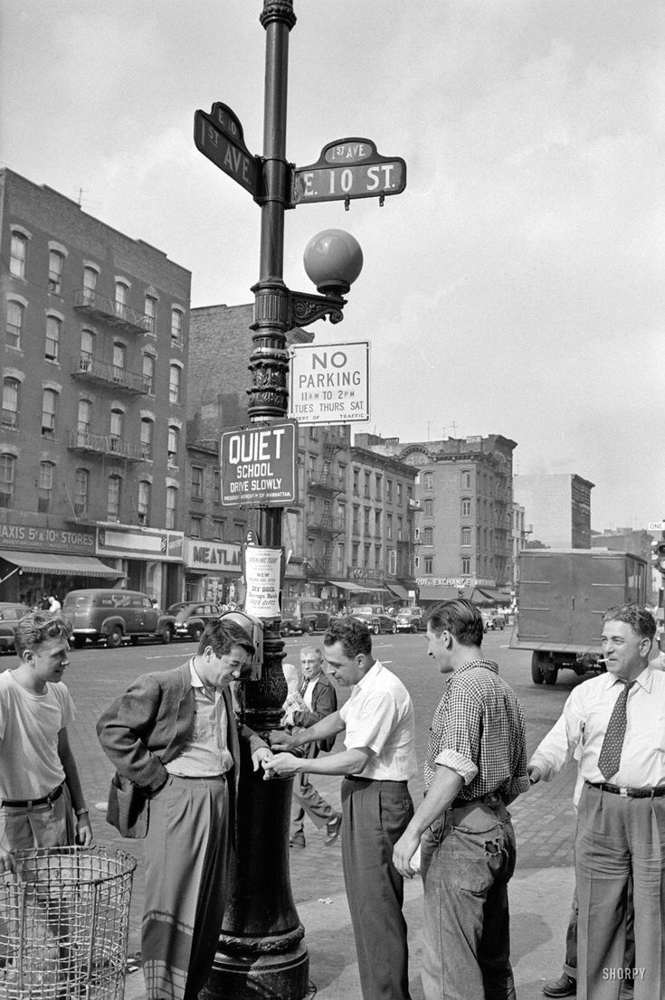"1954. ""Boxer Rocky Graziano walking streets in New York with local boys."" From photos for the Look magazine article ""The Fight of My Life."""