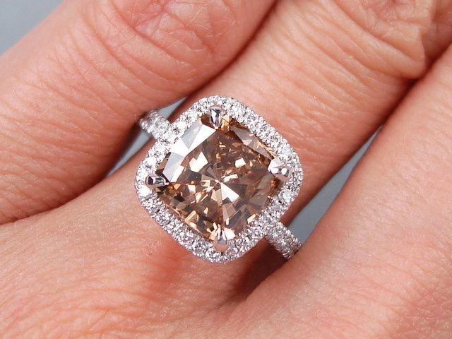 3.00 ctw Cushion Cut Diamond Engagement Ring. It has a rich 2.58 ct Natural Chocolate color/VS2 clarity, Clarity Enhanced (Fracture Filled) Cushion Cut center diamond. Set in a beautiful 14k White Gold setting, this ring is listed for $7,990.  Follow this link to view this listing on our website:  http://www.bigdiamondsusa.com/3ctwcucutdie10.html  Contact Information: 1-877-795-1101   Toll Free 1-312-795-1100   International  Email: diamonds@bigdiamondsusa.com Website: www.BigDiamondsUSA.com