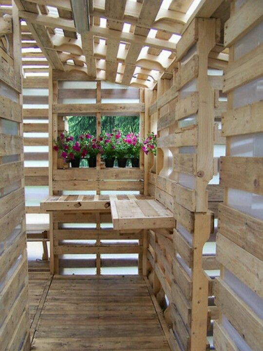 Inside a pallet house.