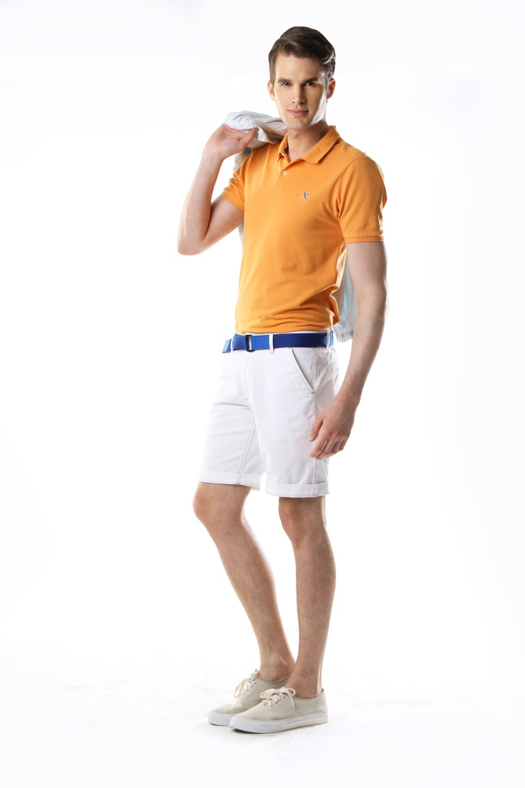 TOP: Papaya Pique polo with contrast underside collar, available in purple, coral, papaya and pistachio    BELT: Blue reversible leather belt    BOTTOMS: Twill walk shorts, available in white; coral and turquoise