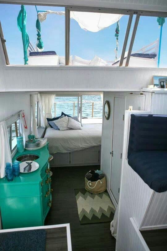 A houseboat is another kind of tiny home. Love the fresh, open feel of this one. (picture only)