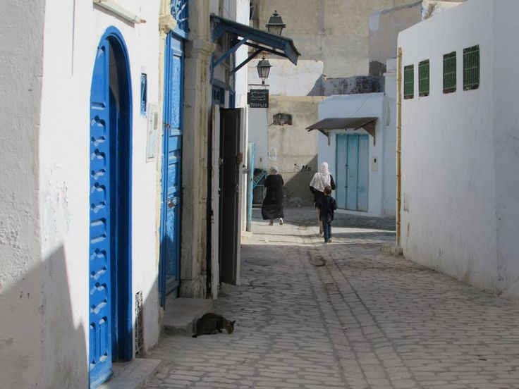 The cobblestone back streets of the medina of Kairouan, Tunisia, tend to be quiet at midday.