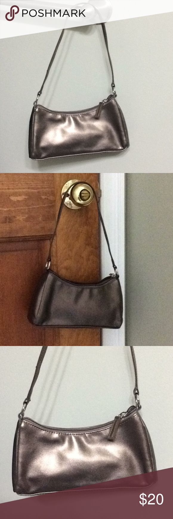 Bronze patent purse small Florence & Fred F+F Authentic Florence + Fred bronze metallic patent purse. Ireland's premier Tesco brand It's dainty and small yet elegant and big enough for the items necessary for date night or the prom! Florence + Fred Bags Clutches & Wristlets