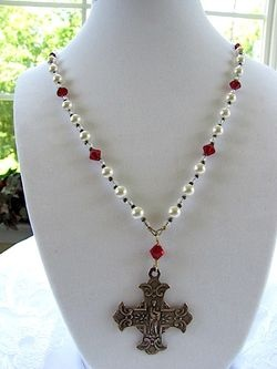 Ruth Tucker's Catholic jewelry designs are awesome! I've worn one of her pearl necklaces for a long time that was like this one. Plus her rosaries are exquisite.  Check out the Sacred Heart earrings and St. Anne's necklace. She takes custom design requests too.Catholic Jewelry, Pearls Necklaces, Custom Design, Anne'S Necklaces, Tucker Absolute Gorgeous, Ruth Tucker Absolute, Design Request, Sacred Heart Immaculate, Heart Pearls