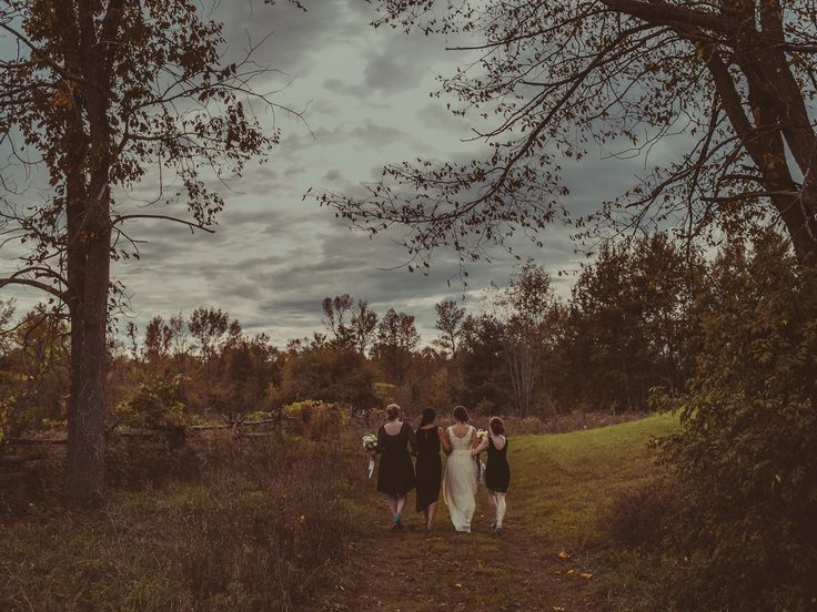Bridesmaids at Stonefields Heritage Farm, Almonte ON; PHOTOGRAPHY Joel + Justyna Bedford; black bridesmaids dresses;