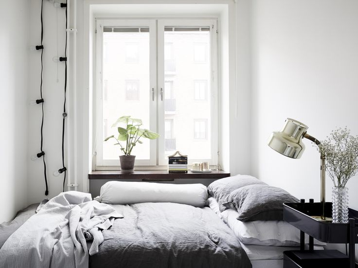 Cozy bedroom in cool grey.