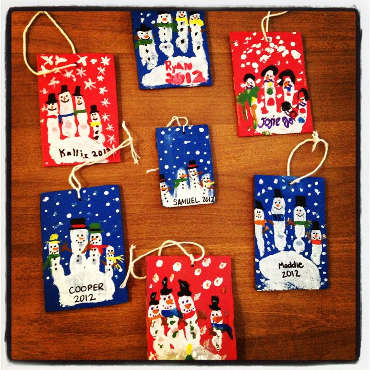 Christmas ornament idea! Finger snowmen painted on cardboard with acrylic paint & tied with twine.