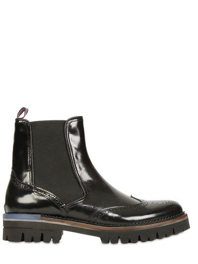 $346, Black Leather Brogue Boots: Embossed Leather Brogue Chelsea Boots. Sold by LUISAVIAROMA. Click for more info: https://lookastic.com/men/shop_items/275768/redirect
