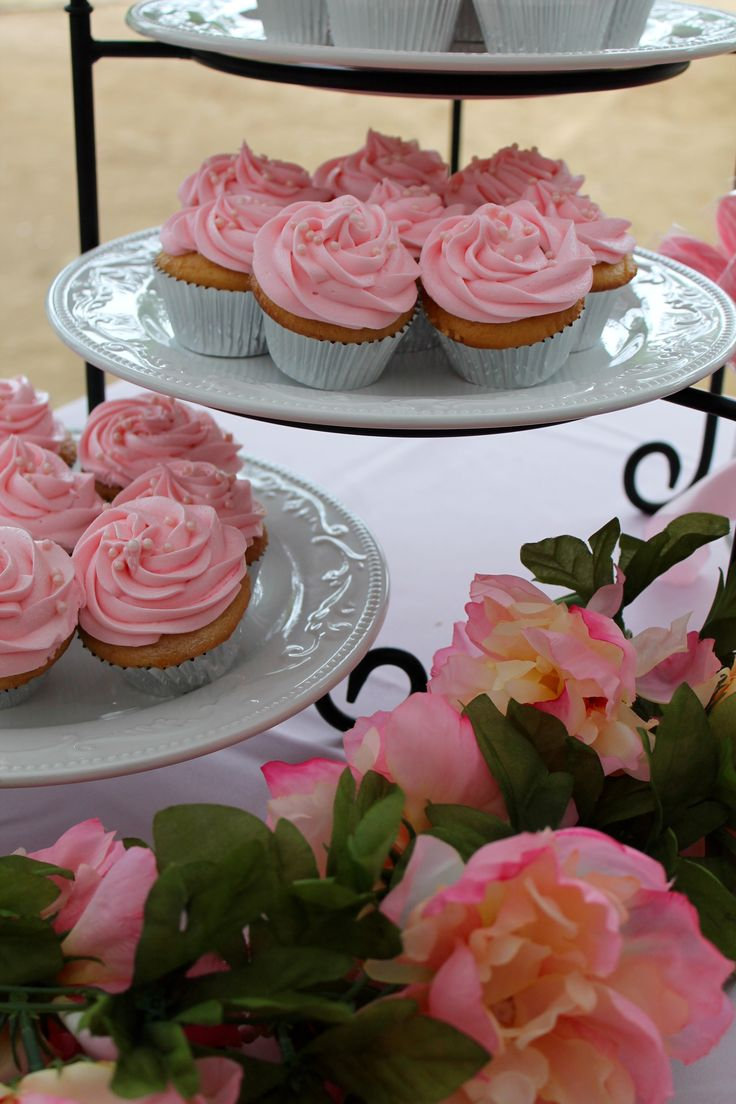 4-tier platter stand with cupcakes.