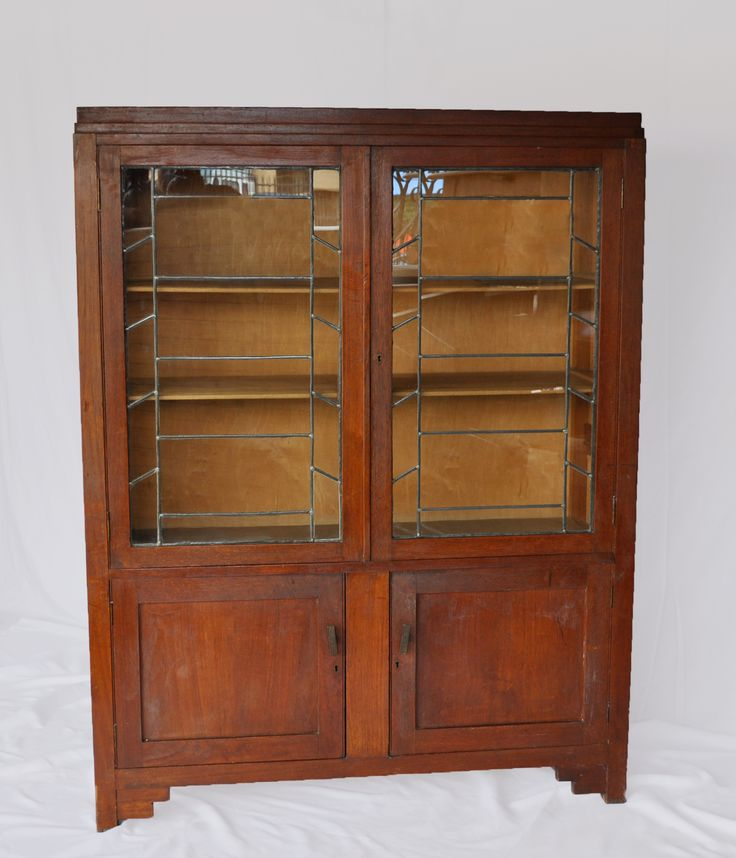 #Sold #NorthcliffAntiques Art Deco lead glass bookcase, ideal for the study, lounge or bedroom. This bookcase is made from teak,has two side by side glass door cupboards with two bottom cupboards. #Johannesburg #Library #Bookcase #ArtDeco #Wood #AntiqueShop