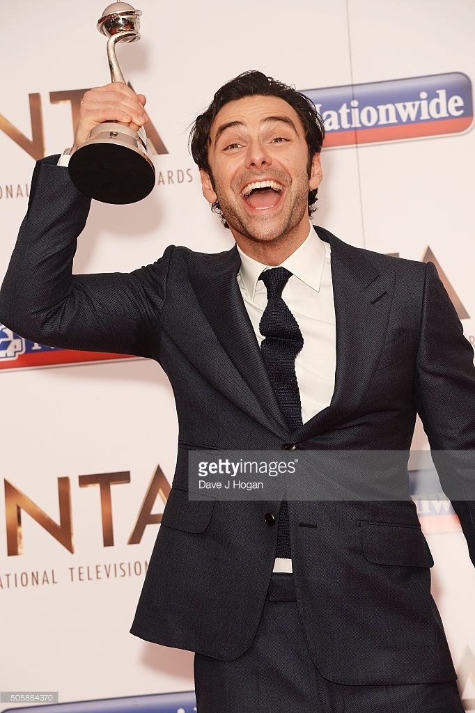 Aidan Turner, with the award for Impact/TV Moment, attends the 21st National Television Awards at The O2 Arena on January 20, 2016 in London, England.