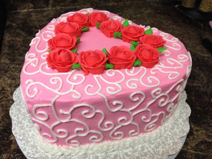 Heart shaped Valentine cake with buttercream frosting and Royal icing roses.