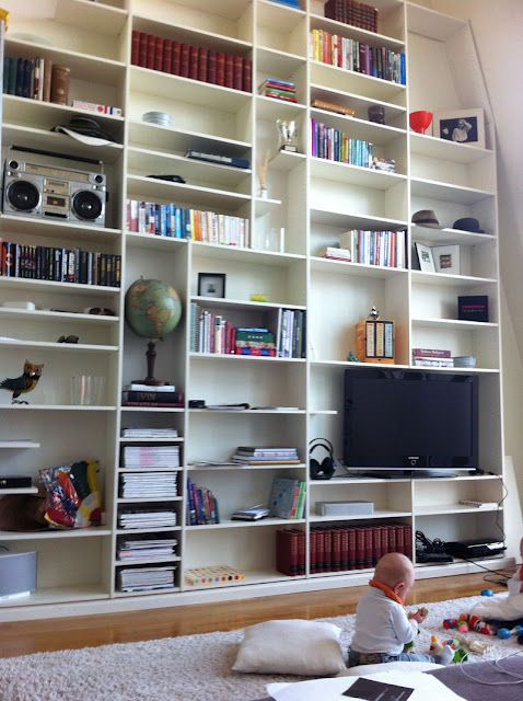 floor to ceiling bookshelf made with 10 Billy Bookcases (8 wide and 2 narrow)