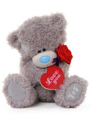 Tatty Teddy is feeling loved this Valentines. Holding a red rose with a special gift tag reading Love You. Clintons £25.