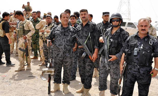 Peşmerge kıyafetli Amerikan askerleri Hüda Par'a karşı