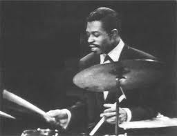 To understand how Louis Hayes revolutionized hard bop drumming, just listen to any of his six albums with Silver.  He delivers a madhouse of intricate rhythms with a lighter touch (as compared to Blakey). Click on pic to see JazzWax  interview.