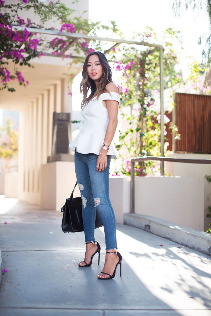 Song of style: white bustier top ripped jeans