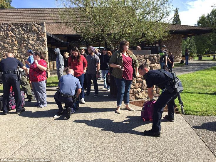 Oregon college gunman made victims stand up and state their religion - then shot them anyway: Twenty-year-old student kills at least ten and injures seven before being shot dead by cops