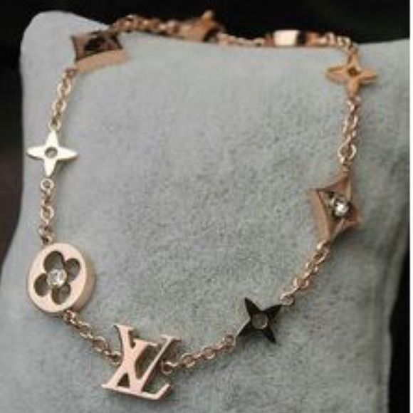 louis vuitton necklace. bracelet new lv inspired . sorry ladies i ordered a necklace and they sent me louis vuitton l