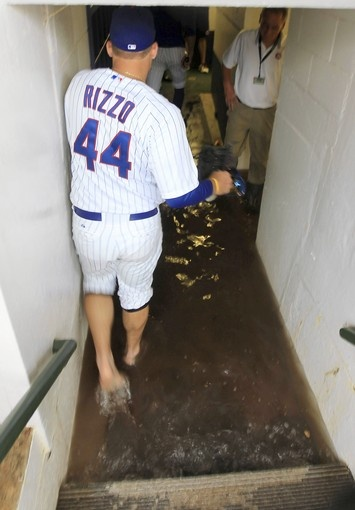 Anthony Rizzo removes his spikes and socks to walk down the flooded walkway to the Cubs' clubhouseRizzo 44, Wrigley Fields, Rizzo Removal, Wrigley Flood, Chicago Cubs, Anthony Rizzo, Flood Walkways, Rizzo Cubs