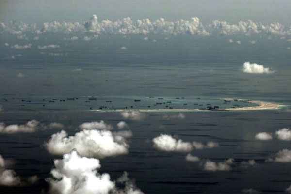 Alleged on-going reclamation is conducted by China on Mischief Reef in the Spratly group of islands in the disputed South China Sea, on May 11, 2015. (Ritchie B. Tongo/POOL/AFP/File)