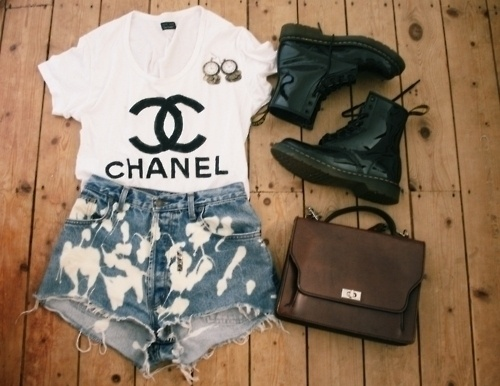 Chanel logo tee, black patent Dr. Martens, vintage Levi denim shorts, Urban Outfitters & vintage bag, Rockit.