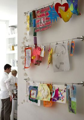 10 clever ways to display kids art work. I love this clothes line style system, and when we are out of toddler years, I am repainting to make a magnetic wall.