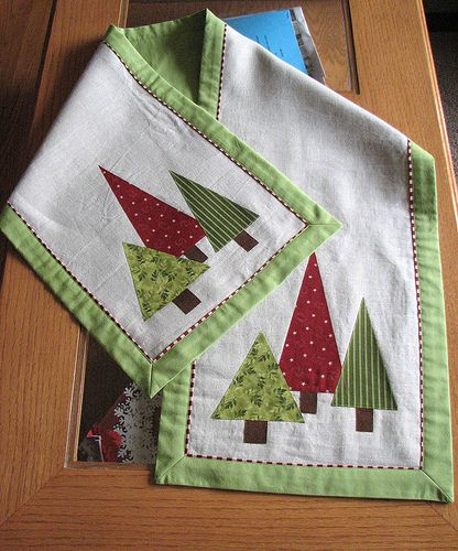 """S asked me to make a Christmas table runner for her shop. Her only suggestions about what it should look like were """"not too fussy or busy."""" ..."""