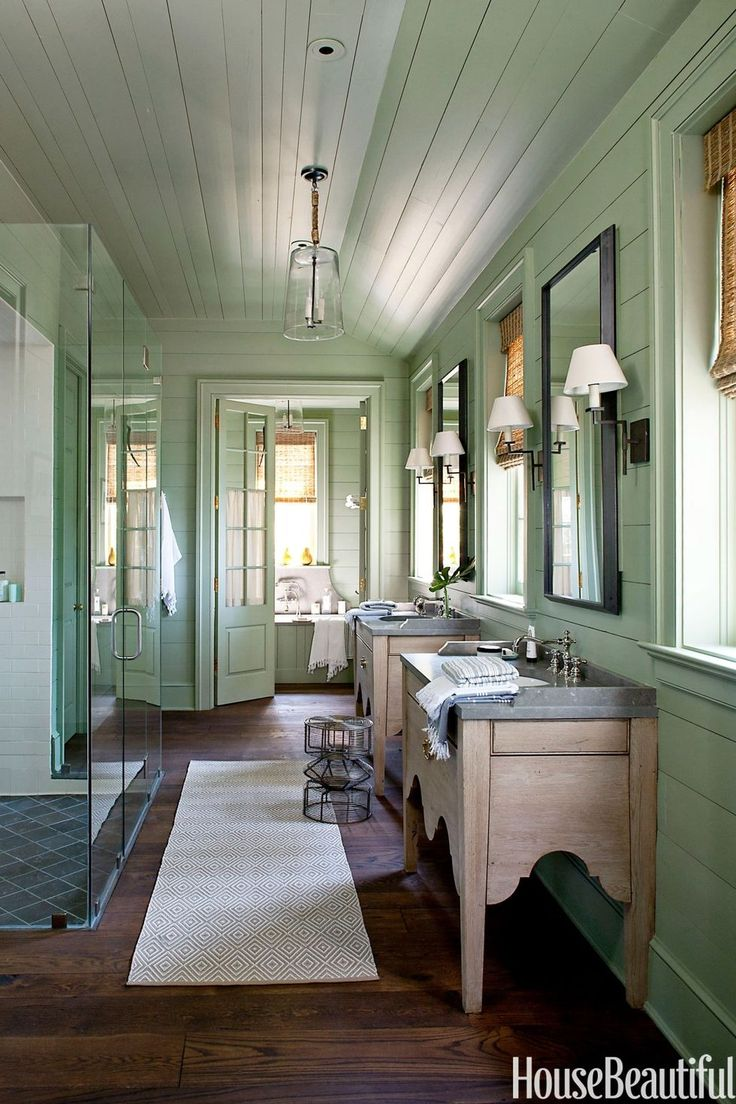 The soft green hue adds to the vintage feel of a bathroom designed by Bill Ingram that's located in a lake house. See more green paint colors for every room at HouseBeautiful.com.