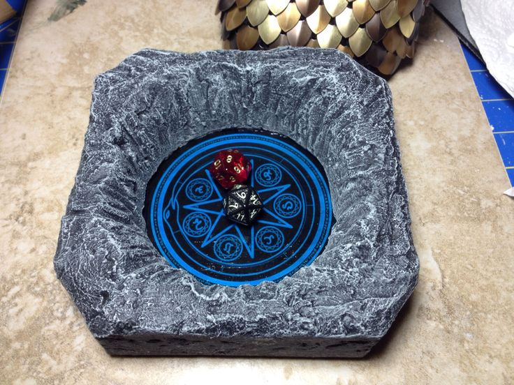 A Custom Dice Tray Cut Textured And Painted Foam Around