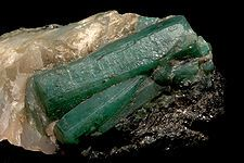 The Bahia Emerald...The gems are actually embedded in a 4 foot by 4 foot by 4 foot granite cube. It weighs 840 pounds with emerald crystals encrusted within the granite. discovered in Brazil in 2001. worth estimated at $400 million.