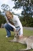 Australia- to the petting zoo to pet koala's and kangaroos and other sorts of exotic pets