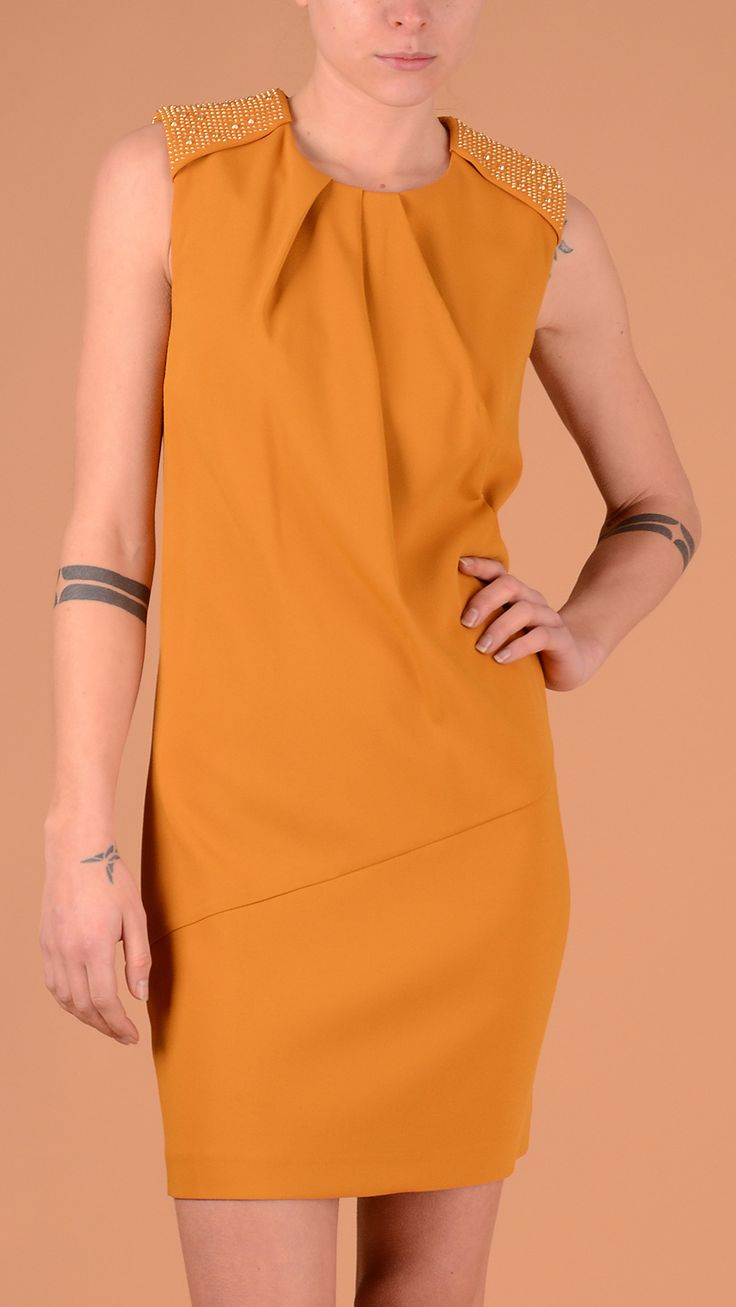 Yellow sleeveless dress featuring contrast golden studs on straps and , concealed back zip fastening, 59% viscose, 37% acetate, 4% elastane.  Size 46.