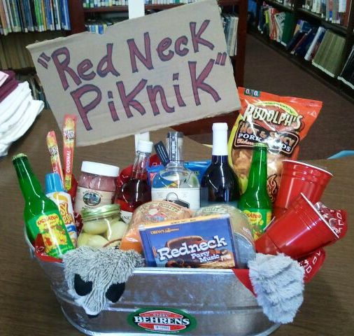 """Redneck Picnic Basket - Silent Auction ideas - includes Camo and Blaze Orange Toilet Paper, Red Solo Cup Wine Glasses, Moonshine, Slim Jims, Pickled Eggs, Pork Rinds, Redneck Party Music CD, Racoon """"Roadkill"""" Dog Toy, Boones Farm Wine, Easy Cheese, and Pickled Pigs Feet"""