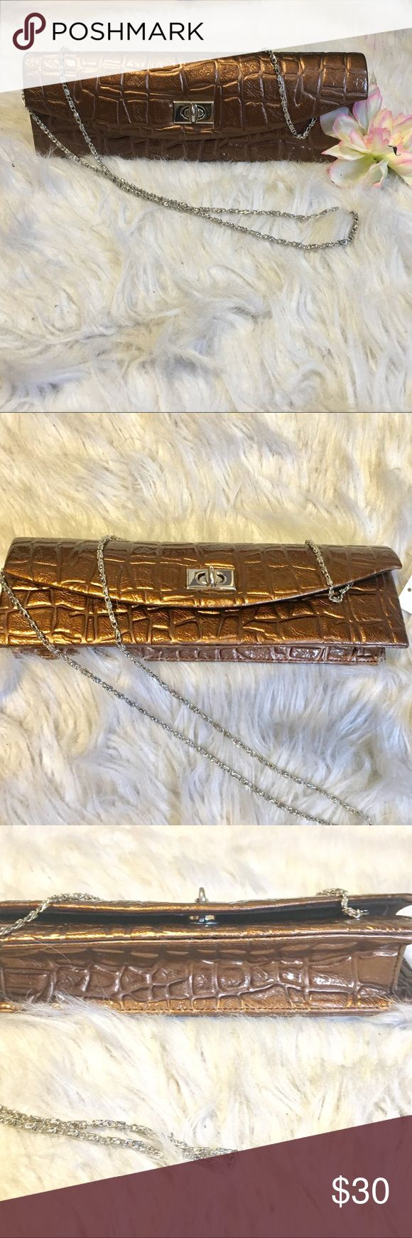 "Platinum metallic shoulder/clutch bag Gorgeous platinum metallic clutch bag. Inside small pocket. 11"" width 4"" length. Has adjustable silver chain that can come off. Bags Shoulder Bags"