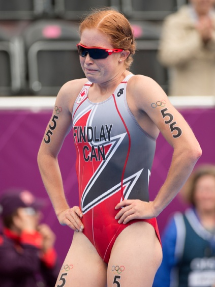 An emotional Paula Findlay of Canada crosses the finish line in the triathlon at the 2012 London Olympic Games August 4