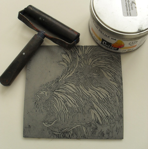 Dog linocut plate and tools before printing by rowanne