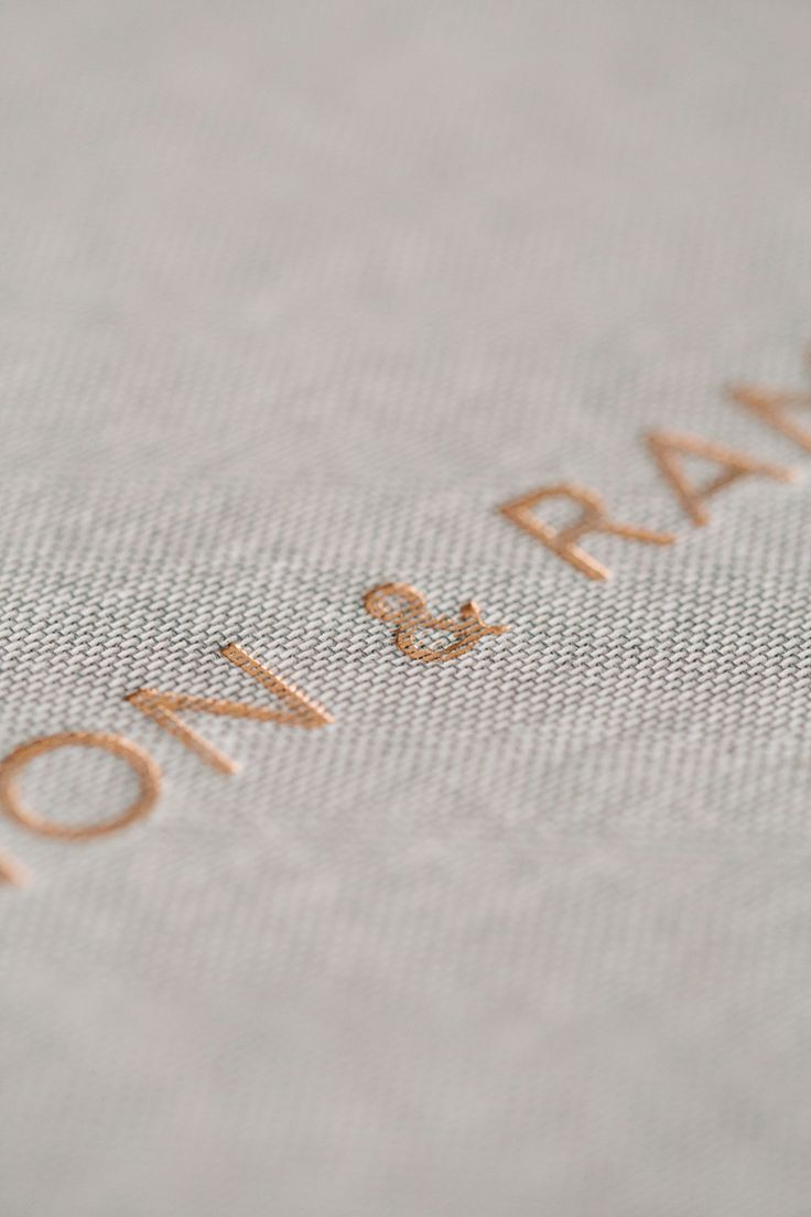 Luxury bespoke hand made wedding album fine art photo books engraving engraved lettering photography linen