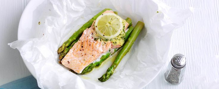 Lemon and garlic trout parcels with asparagus