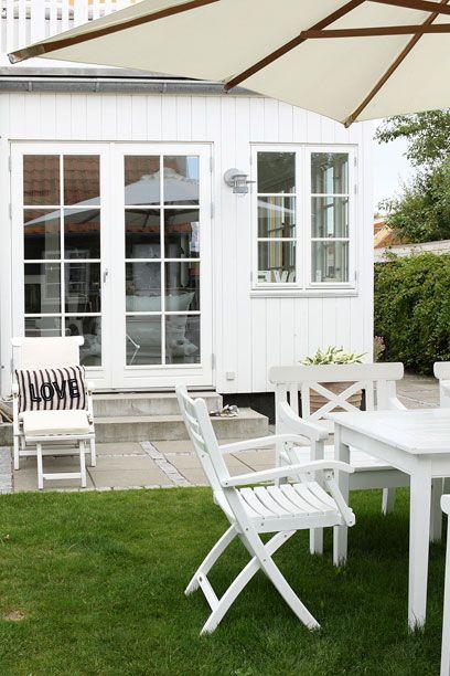 Danish Seaside Cottage:  Painted white furniture.