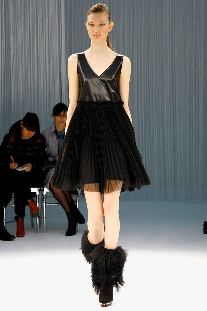 Beautiful little black dress;pleated circle skirt and leather bodice#PFW#F/W2011#RTW