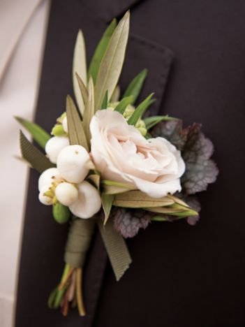 The groom's boutonniere will be white spray roses and white snowberries wrapped in ivory ribbon with the stems showing.
