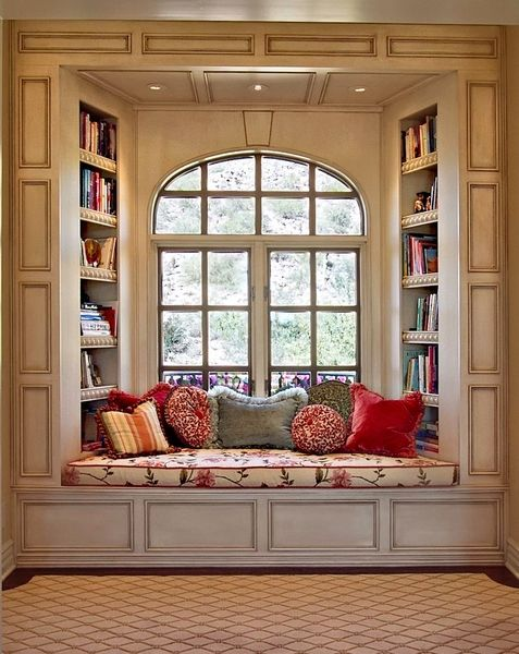 Can't you just picture yourself sitting here with a good book and cup of coffee while the snow falls out the window... I can :)
