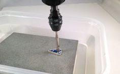 Usind your Dremel drill with a diamond drill bit in a water trough to drill hole… – Rock It